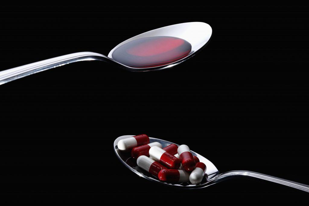 An image of a spoon full of vitamins to take for nerve pain