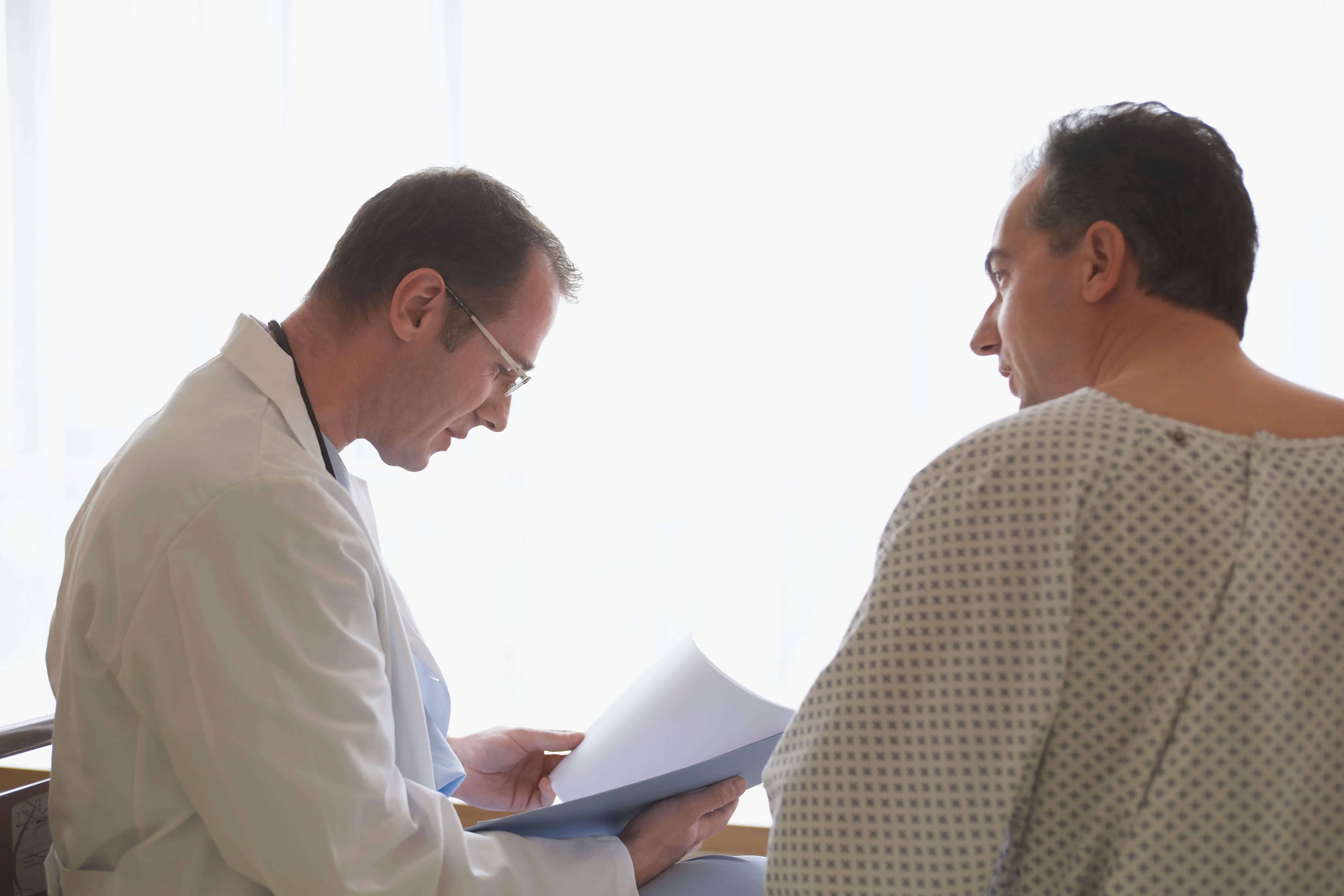 Doctor sitting with patient explaining treatments for diabetic neuropathy
