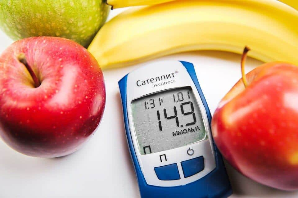 Diabetic monitor with apple and banana